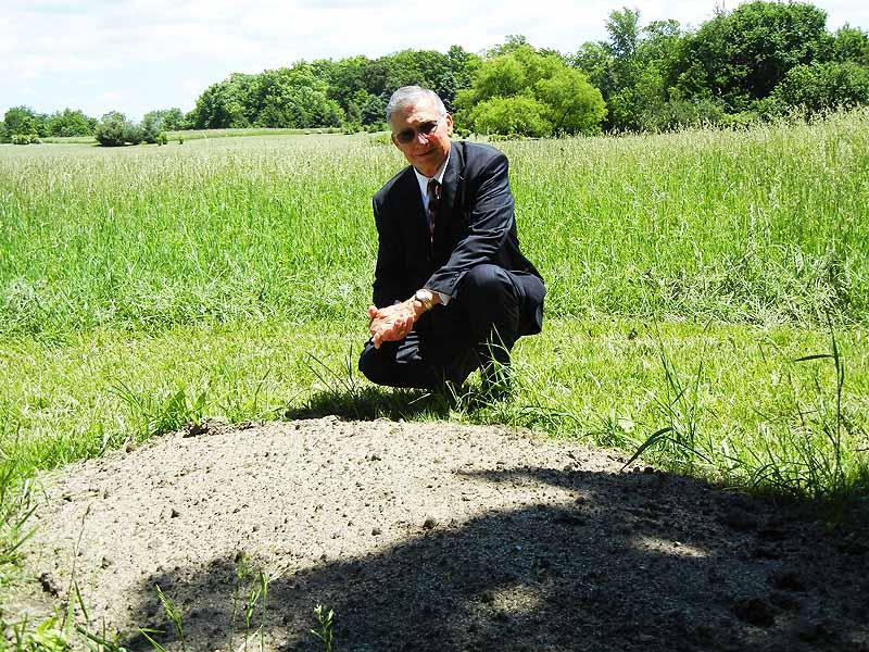 Ronald Zartman beside the first natural burial at Ridgeview Memorial Gardens.
