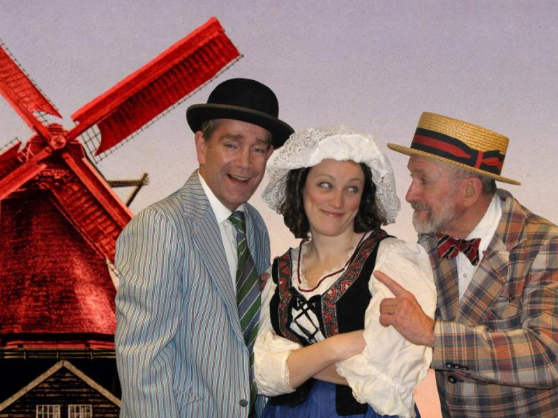 Giles Simmer stands between two other characters from the production 'The Red Mill' with the Comic Opera Guild in 2012.