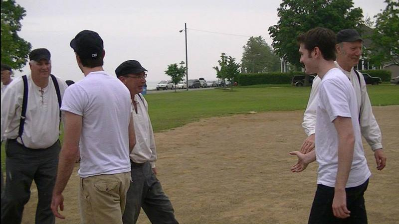 Members of the Continental Base Ball Club shake hands with their opponents after a game.