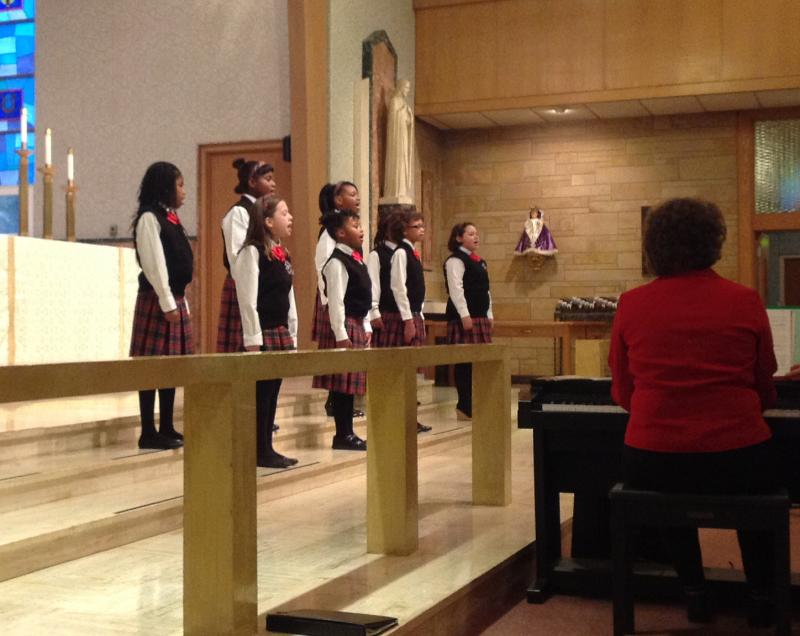 The Eastside choir performing at St. Mary's Catholic Church during the Kalamazoo Children's Chorus Christmas concert.