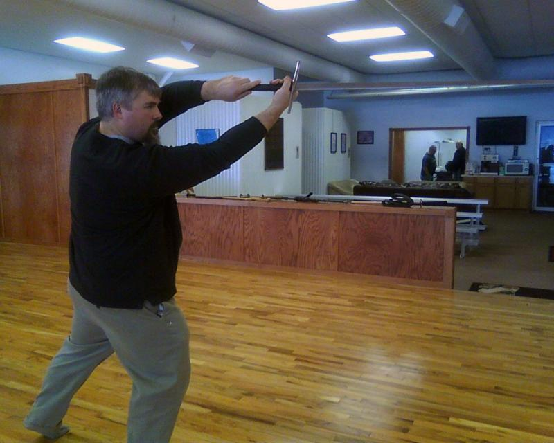 Keith Nelson demonstrating a move with a knightly long sword