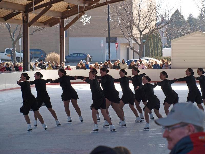 Ice skaters glide in sync at a past Ice Breaker Festival.