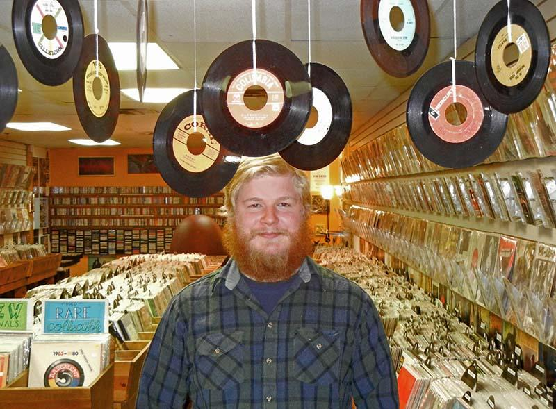 Co-manager Sean Hartman at The Corner Record Shop and Audio in Kalamazoo.