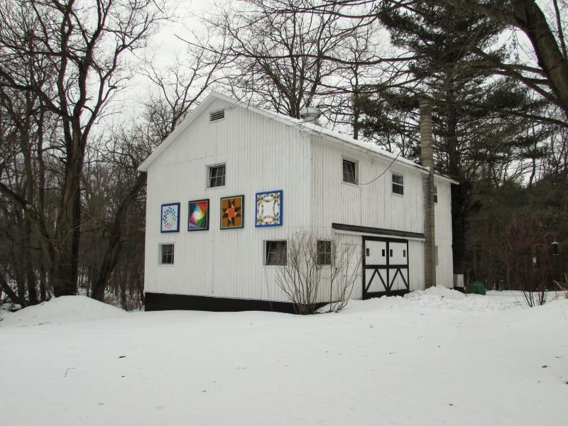 "The ""Quilt Gallery"" of barn quitls created by four area guilds was the last to be hung in December 2013."