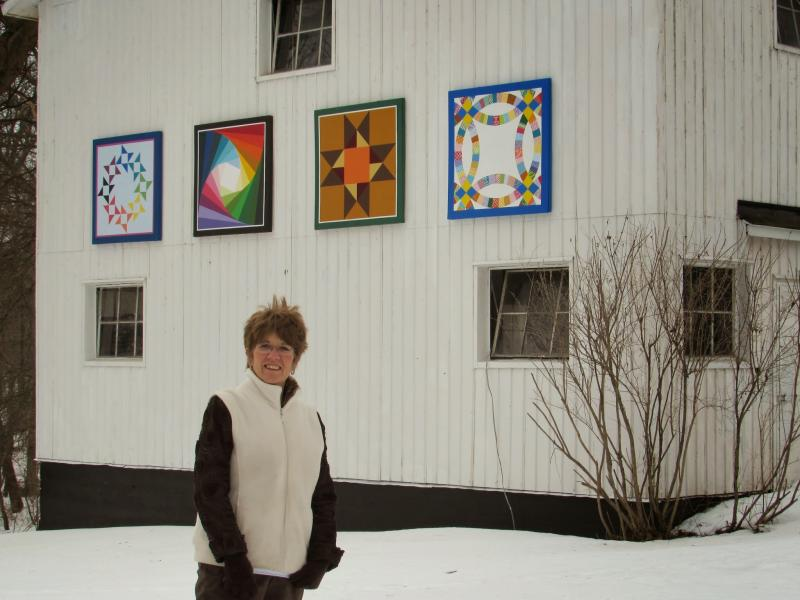 "Vicksburg Quilt Trail creator Kitch Rinehart stands in front of the ""Quilt Gallery."" The quilt created by her guild is on the far right."