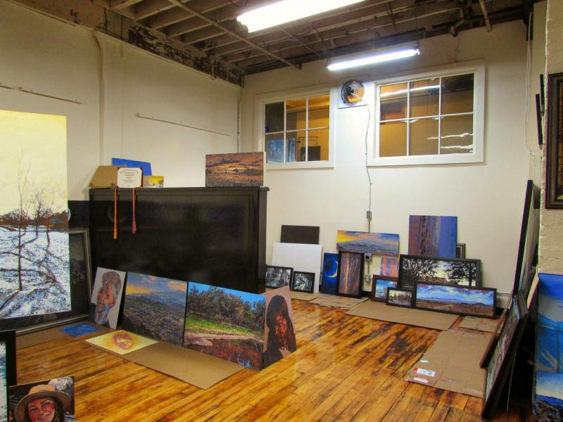 Gustafson's studio is is filled with vivid, but not quite lifelike paintings of carefree individuals, nighttime rooftop views, and landscapes of neighborhoods, farm and sea as portrayed through snowy winters, verdant springs, and hot summer days.