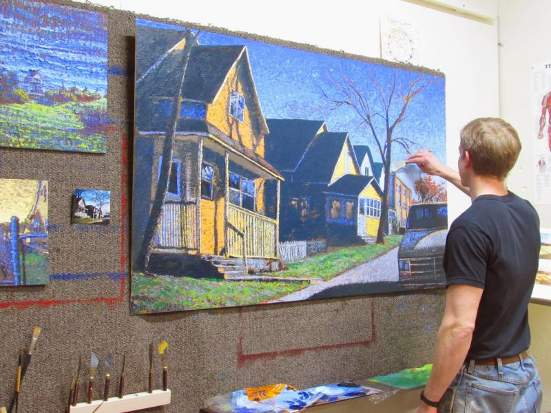 Gustafson at work on his series 'If You Lived Here You'd Be Home Now.' The collection is inspired by the unique aspects of houses and residential buildings in the Midwest.