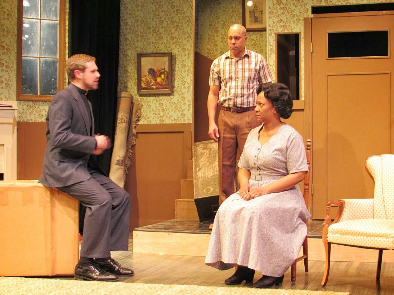 In act one of Clybourne Park, neighbors try to figure out just why a black family would want to subject themselves to such a different environment. From left: Colin Woodside, Von Washington Jr. and Dwandra Lampkin.