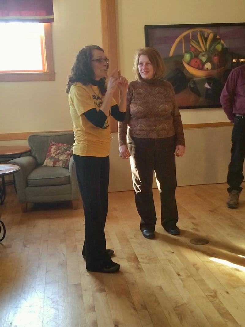 Angēla Essick Dykes leads a laughter yoga class at Gilda's Club in Grand Rapids.