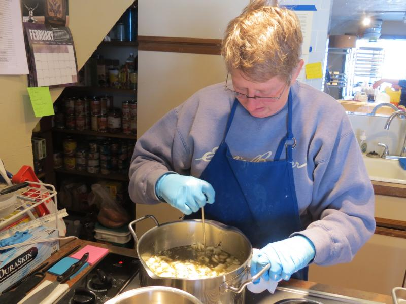 Valerie Lane of Brickyard Farms mixes together oils for a batch of soap