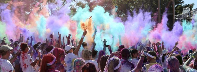 People throw colored powder in the air during a party festival at the Color Run in Sydney, Australia, Sunday, Feb. 9, 2014.