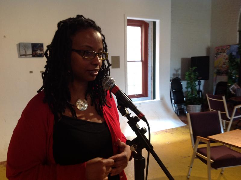 """Denise Miller reading her poem """"Speak Easy"""" at Fire Historical and Cultural Arts Collaborative."""