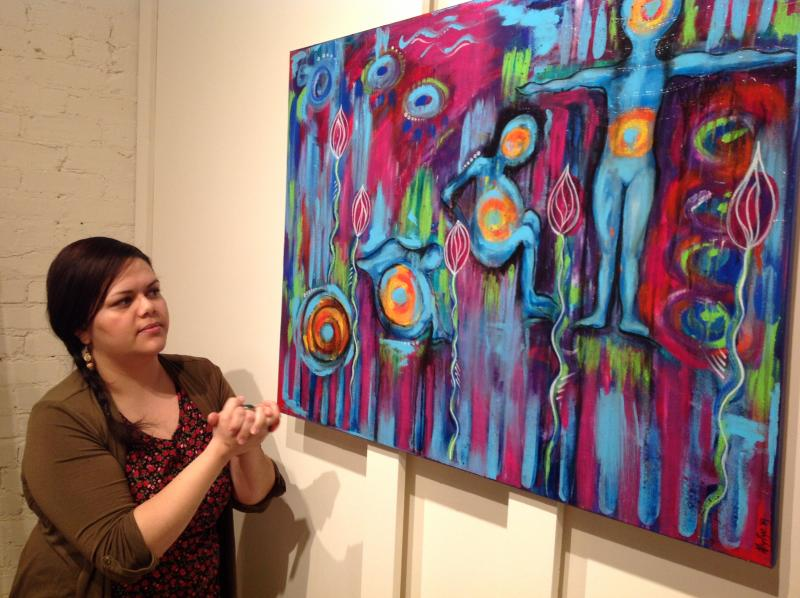 Alessandra Pye stands next to the last piece in her series