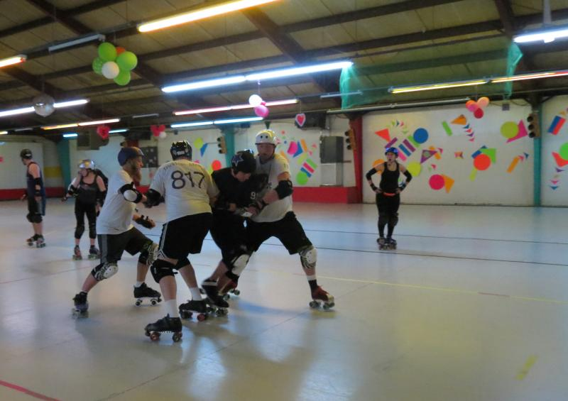 The Kalamazoo Men's Roller Derby Team practicing at Roller World