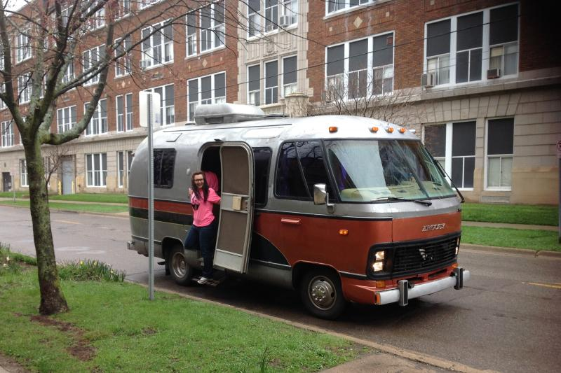 Executive Director Carol Zombro steps out of the Fancy Pants Theater motorhome in the Kalamazoo Vine Neighborhood