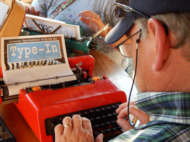 A typist on an Olivetti Valentine model that was popular in the 1970's