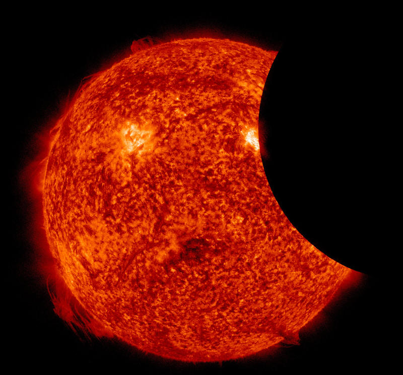 The sun and moon during a partial solar eclipse