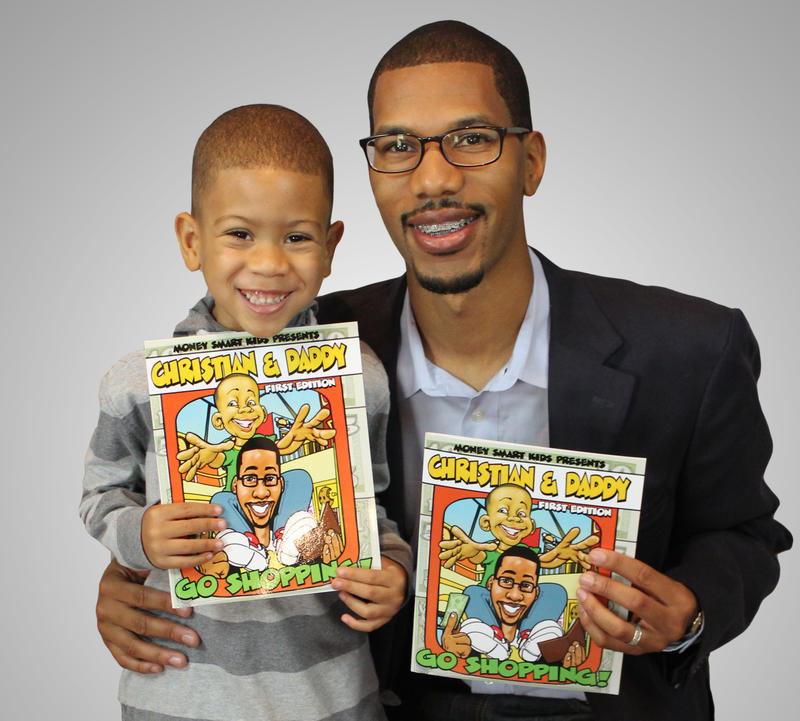 Stanley Steppes and his son Christian holding copies of Steppes' book 'Christian and Daddy Go Shopping'