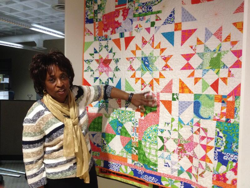 Leslie Dewberry in front of her improvisational quilt