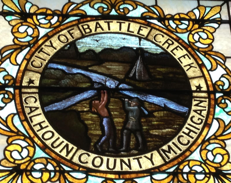 A stained glass image of the official Battle Creek city seal can be seen on the main interior staircase of city hall between the second and third floors