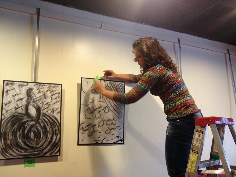 Cheri Williams hangs her work at Studio Grill in Kalamazoo
