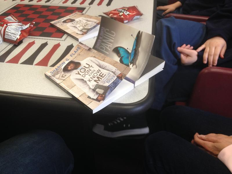 On the left is the last book the girls read in book club 'You Don't Even Know Me: Stories And Poems About Boys' by Sharon G. Flake. On the right is the current book 'Panic' by Sharon Draper.