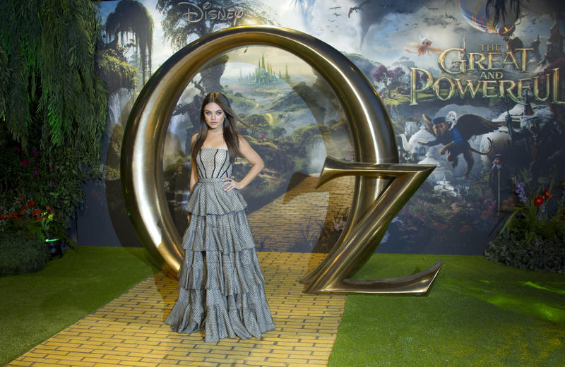 Actress Mila Kunis arrives at the European premiere of Oz: The Great And Powerful at a central London cinema, Thursday, Feb. 28, 2013.