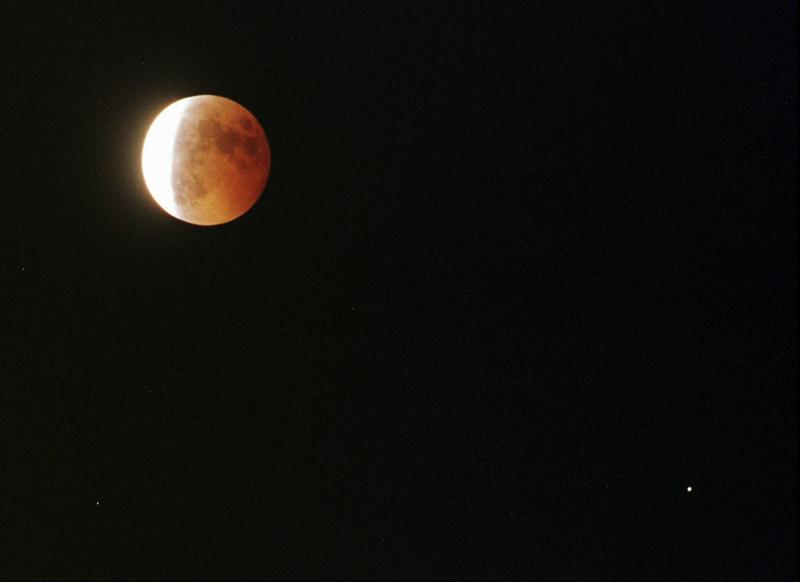 The planet Saturn can be seen diagonally to the right of the moon during a total lunar eclipse seen from Emeryville, Calif., Thursday, September 26, 1996.