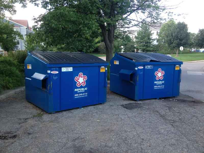 Two recycling bins at Gull Run Apartments in Comstock