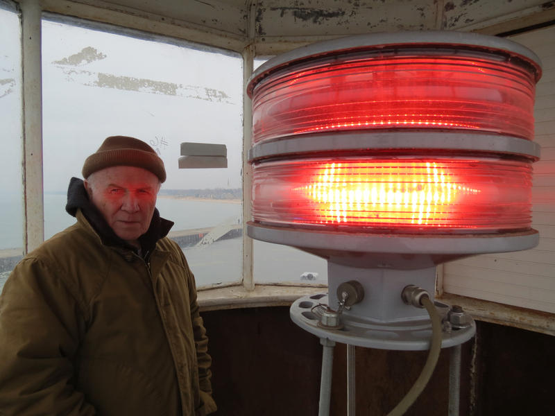 Ed Appleyard of the Historical Association of South Haven stands near the light inside the old South Haven Pier Lighthouse
