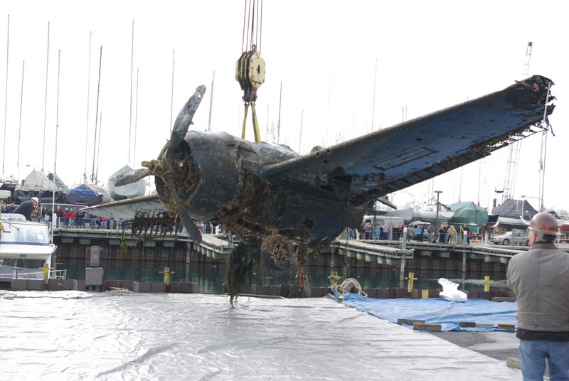 A diving crew recovers a Wildcat fighter plane from the depths of Lake Michigan. This photos is a still from the documentary.
