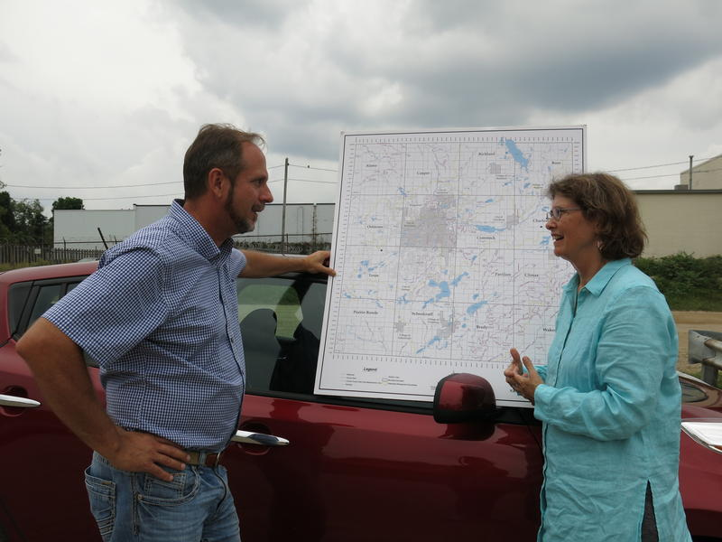 John Cincilla (left) and Kalamazoo County Drain Commissioner Pat Crowley with a map of the county's drains