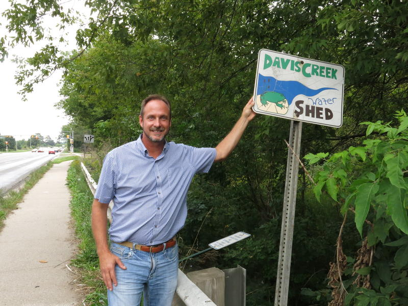 John Cincilla with the Davis Creek Watershed sign along Sprinkle Road