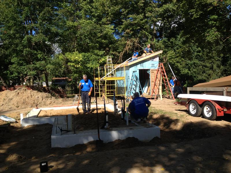 Habitat for Humanity volunteers finished pouring the foundation at the site of Ben Brown's tiny house. Behind it is Brown's garden shed, not that much smaller than the house itself.