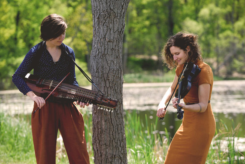 Swedish folk musician Anna Gustavsson (left) playing the nyckelharpa and Michigan folk musician Laurel Premo on the fiddle