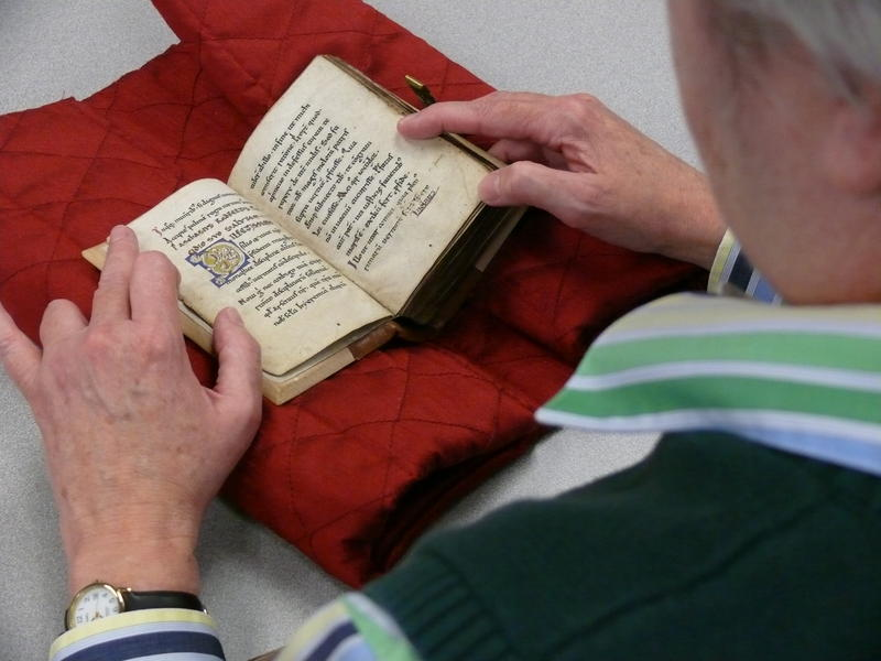 Elizabeth Teviotdale of the Medieval Institute flips through the pages of the 800 year old manuscript