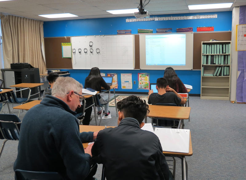 8th graders work on a math assignment at Covert Public Schools