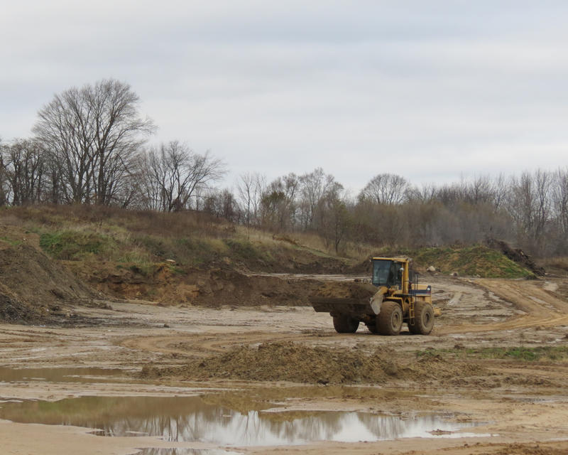 A truck hauls dirt to a corner of Top Grade Site Management's Salem Pit in Dorr. Top Grade says this pit is similar to the one proposed in Richland Township.