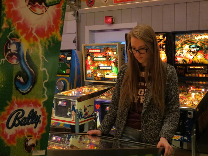 Sarah Schudel in the game room at her parent's home in Kalamazoo - the site of this year's state championships for pinball.