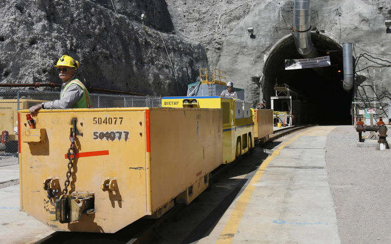 In this April 13, 2006, file photo, Pete Vavricka conducts an underground train from the entrance of Yucca Mountain in Nevada.