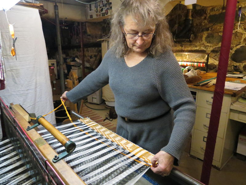 Lou Ann Morgan weaving on her antique loom