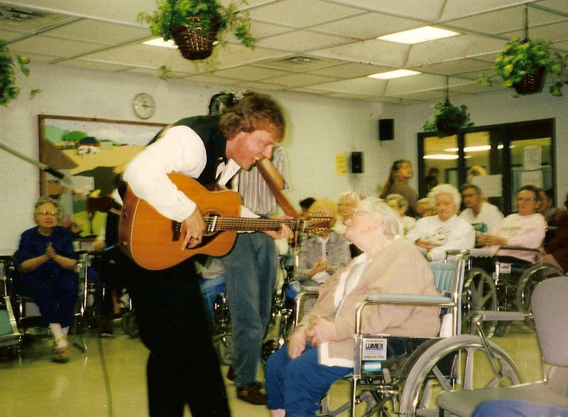 An old photo of Bob Rowe performing for seniors in Calhoun County