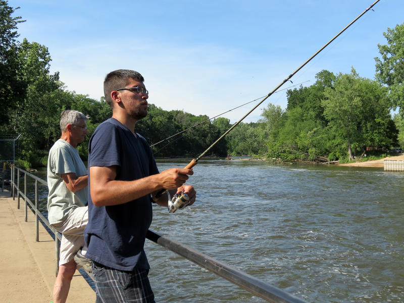 Ryan Dy of Holland (right) and Tom Fik of Allegan (left) fishing at Allegan Dam