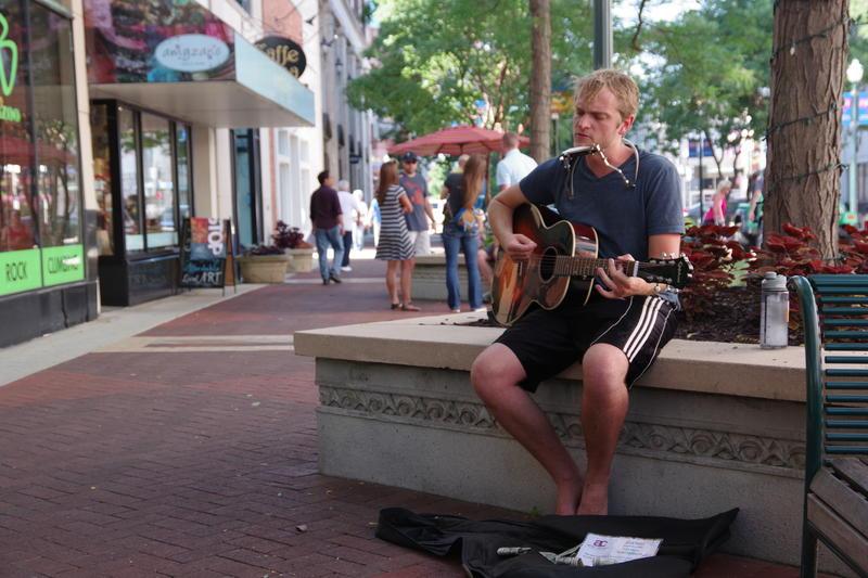 Musician Brian Laliberte busks during the downtown Kalamazoo Art Hop