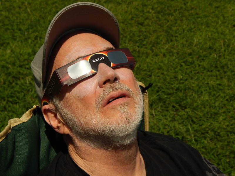 Kevin Berwin of Chesterfield, Missouri, watches the eclipse unfold