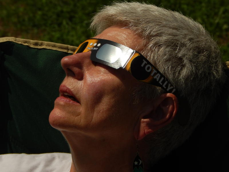 Susan Hegger of Saint Louis witnesses the eclipse