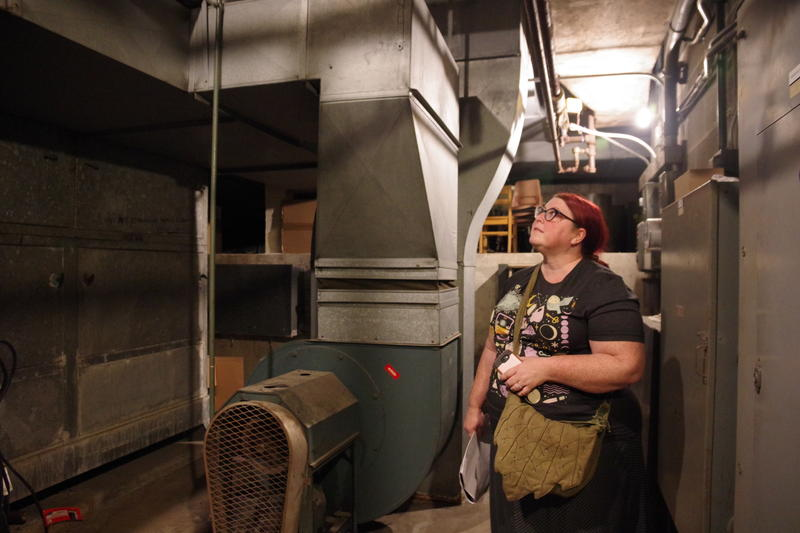Sarah Schneider Koning in First Congregational Church's sub-basement, a onetime fallout shelter.