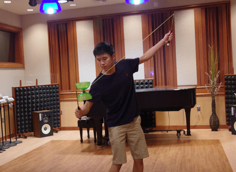 Portage Central High School junior Jack Liu does a yo-yo trick at WMUK's Takeda studio