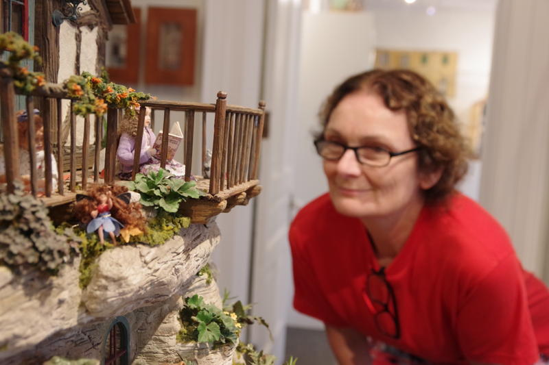 Wendy Habermehl of Milwaukee looks into the magical treehouse at the Midwest Miniatures Museum in Hickory Corners