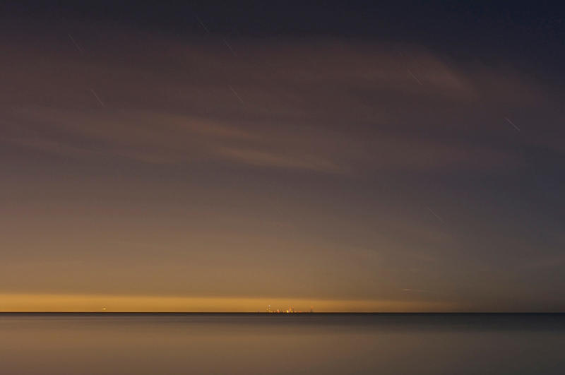From this beach in Burns Harbor, Indiana, you can see an orange glow radiating off of the Chicago skyline